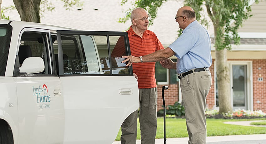 Landis at Home vehicle picking up retired man from his house